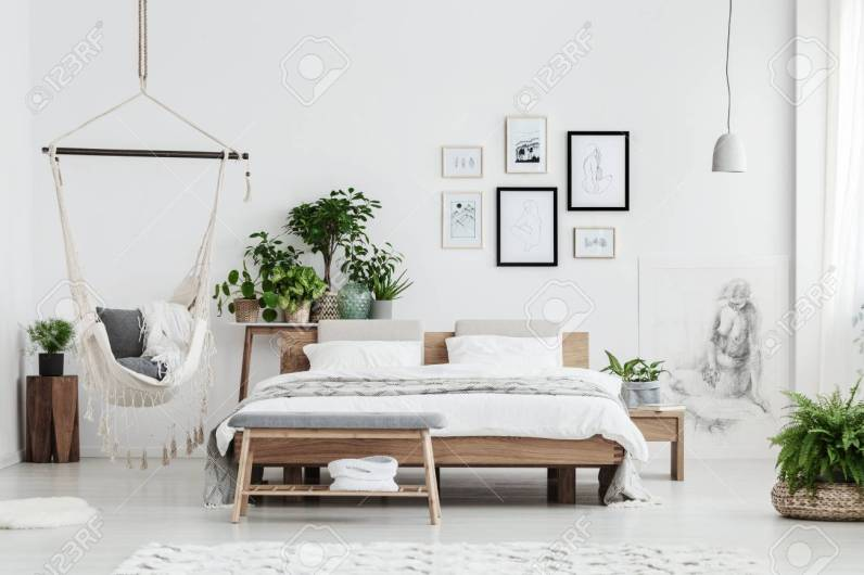 Hammock With Blankets Near Plant On Wooden Stool And Bed With pertaining to 14+ Awesome Indoor Hammock Ideas For A Lazy Sunday Morning