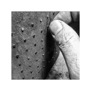 Jim Bridgeman Ceramic Artist - Inserting Nails into Pot