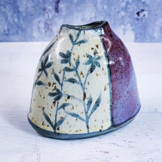 LaPella Pottery - Wheel thrown oval vase, altered, and hand painted with wildflower silhouettes