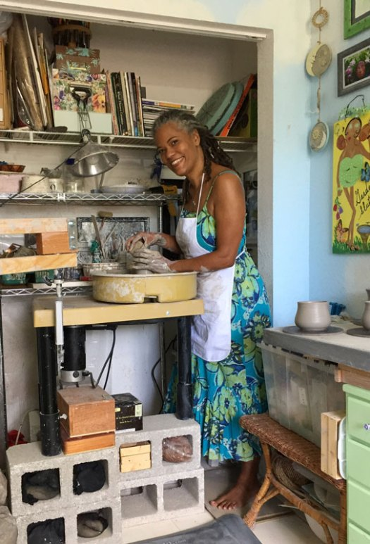Karrita Renzelmann of Queen Bee Pottery in her studio