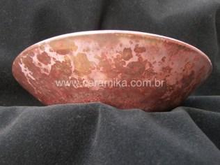 cristais vermelhos no vidrado ceramico
