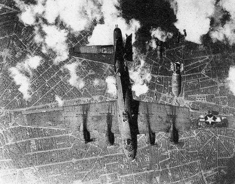 1415229146243-a_doomed_b_17_over_berlin_was_hit_by_bombs_from_a_higher_b_17___1944