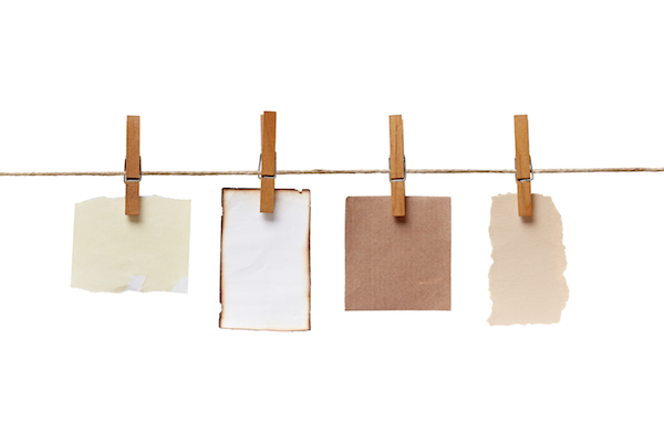 close up of a notes and a clothes pegs on white backgroundcollection of various notes and a clothes pegs on white background with clipping path