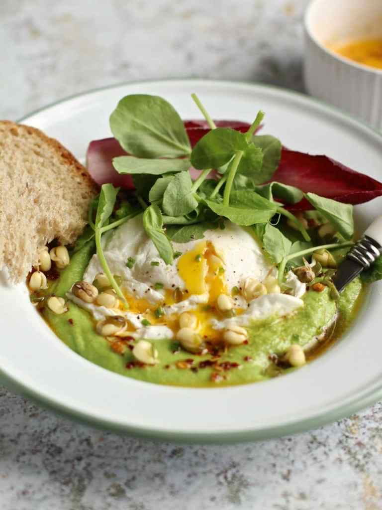 A riff on Turkish Eggs, with a base of Pea Puree, Poached Egg, Chilli Butter and Pea Shoots. Vegetarian. Spring