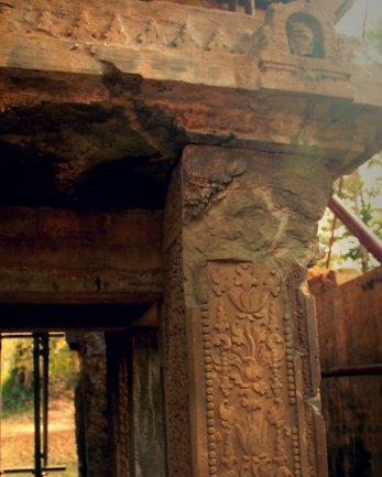 Sandstone structure inside Mandapa of Prasat Yeai Poeun with Kudu on top right corner