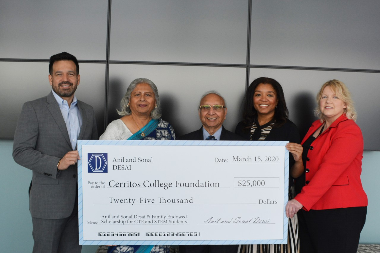 Dr. Jose Fierro, Sonal Desai, Anil Desai, Monica Lee Copeland, and Carol Krumbach holding $25,000 check presentation