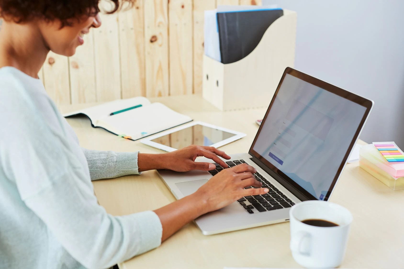 Woman using her laptop on her work desk