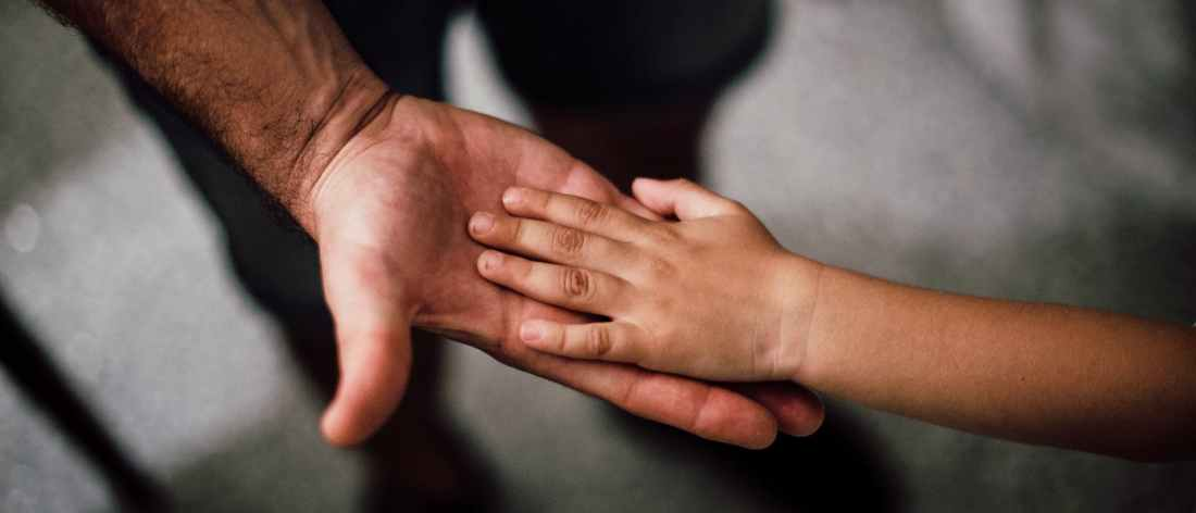 selective focus photography of child hand