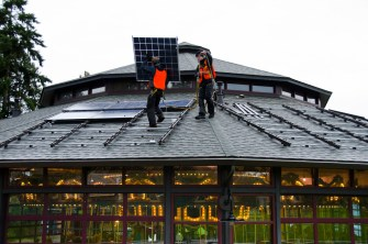 installing solar panels on historic carousel roof, energy, solar panel