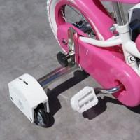 Apprendre à faire du vélo sans tomber avec les stabilisateurs JustED
