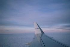 KL 1854 - Zartes Morgenlicht über den Wolken auf dem Weg nach Amsterdam