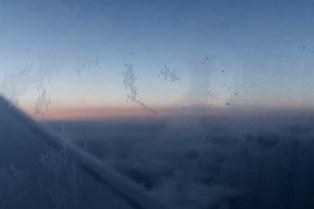 EW 354 - Sonnenaufgang früh Morgens im Flugzeug von Köln nach London