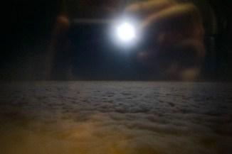 Vollmond über dem Wolkenmeer