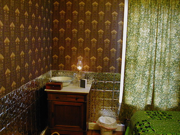 """In the Victorian era, the Chrismans' home would have had wallpaper in every room. They've only been able to paper one room so far; the pattern, """"Imperial Artichoke,"""" is a replica of an 1893 wallpaper pattern. (From ThisVictorianLife.com)"""