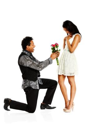 Man proposing using flowers