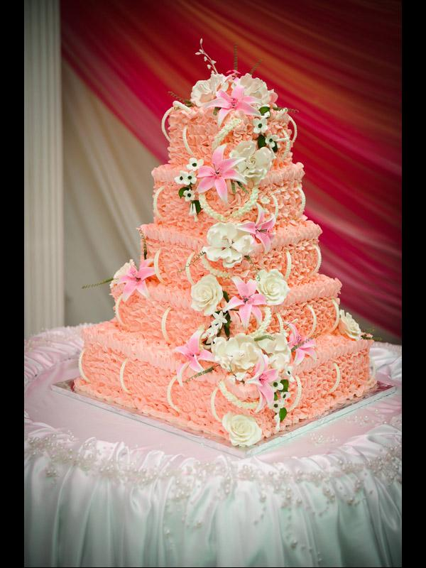 Buttercream Wedding Cake Designs   LoveToKnow pink ruffle cake