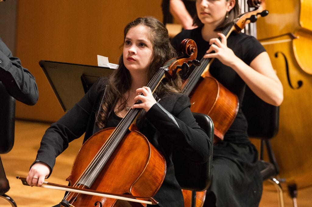 Carys Quezada playing the violin