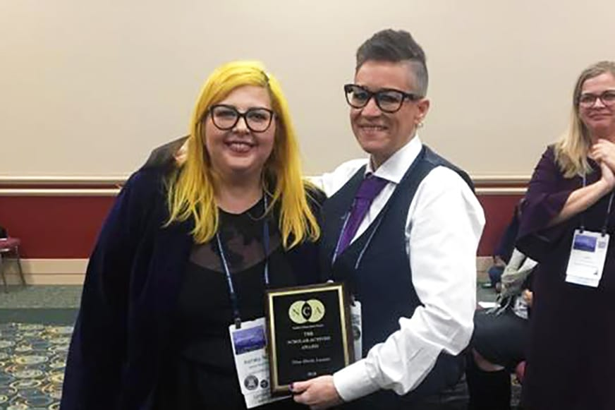 Nina Lozano receiving her award.