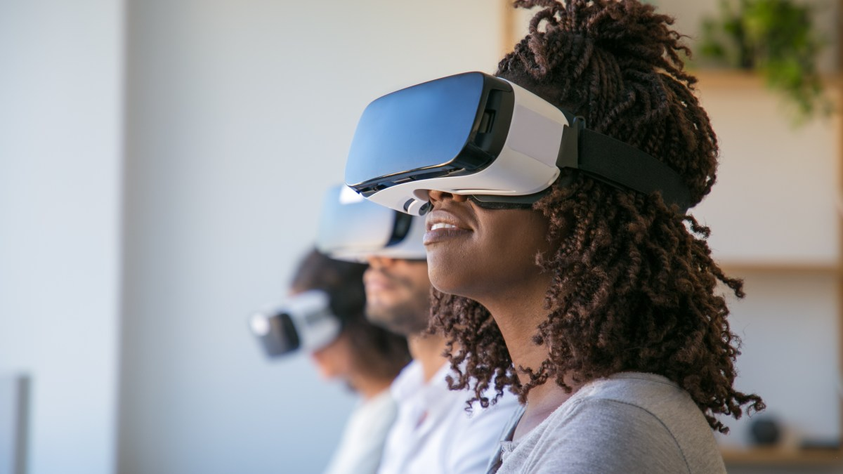 Excited users testing VR game