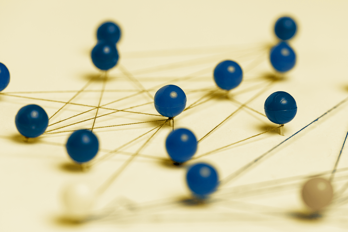 Blue Pins on Yellow Paper