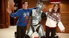Doctor Who's Matt Smith (The Doctor) and Karen Gillan (Amelia Pond) wearing their Christmas sweaters. No Christmas sweater for the Cyberman?
