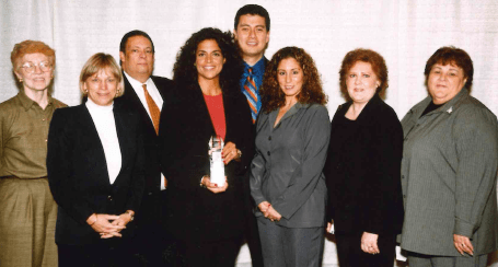Lucia DiNapoli Gibbons (center, with award), Wachovia's Regional President for Northern New Jersey, flanked by representatives from nominating nonprofit organizations at the 2003 Corporate Philanthropy Awards Dinner.