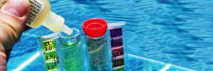 Checking Pool Chemicals as part of pool service in Lakeland, FL
