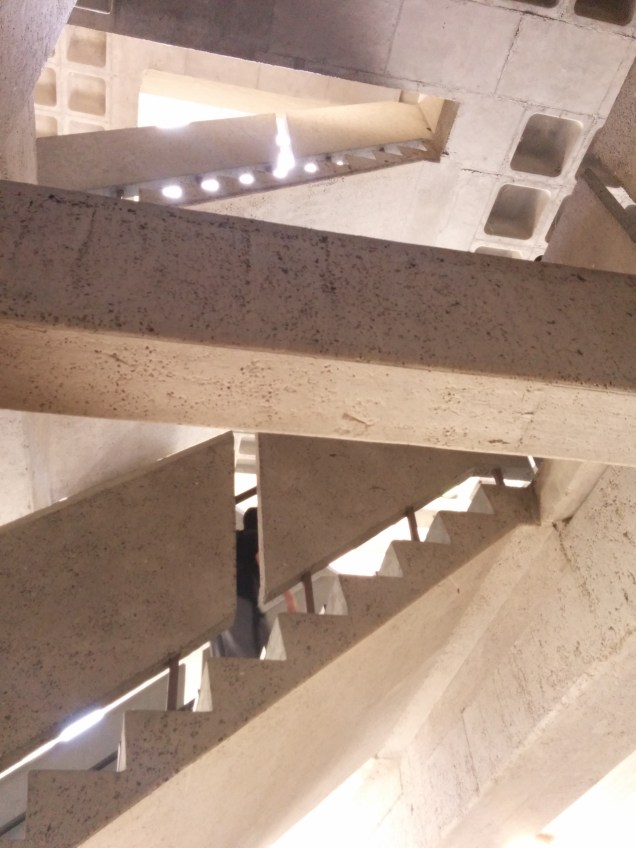 Surrealistic scene, looking up from the first level onto staircases above near the G building.