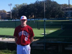 A University of Indiana pitcher stands outside Sessions Stadium before the Hoosiers' baseball game with JU.