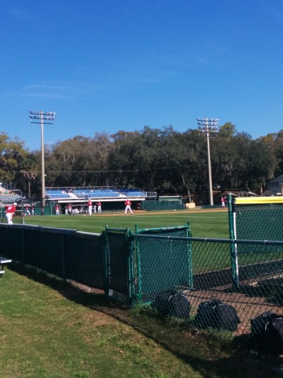 A look from behind the bullpen as Indiana players warm up before baseball at JU.