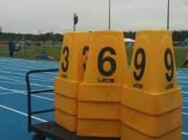 These are track lane markers, stacked when not in use. They're also useful for people who forget how to count by 3's.