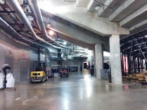 The media entrance leads through the obscure hallways of the arena, a land of concrete columns and pipes.