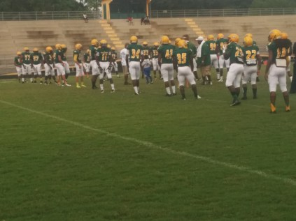 Ed White High School players warm up before near-empty seats against rival Westside.
