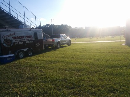 Food trailers are also popular at high school football, like this mobile barbecue eatery setting up as players practice at First Coast High School.