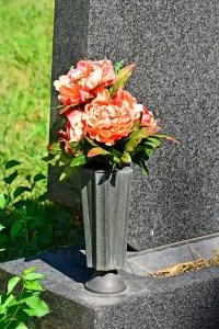 Memorial vase at base of headstone