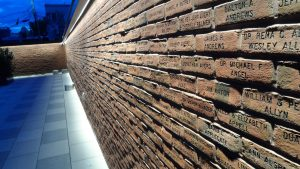 Wall of engraved donor recognition bricks