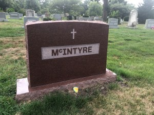 Granite monument in Wausau Red with raised polished lettering