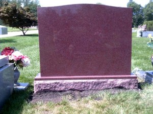 Back view of upright headstone in Red Granite