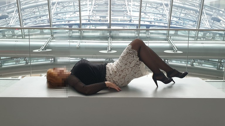 Dipl.Eng. Sofia and escort service at the Hilton Frankfurt Airport Hotel lying on the pedestal in front of the panoramic window