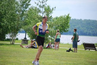 Chad Couto runs outdoors during a fitness marathon.