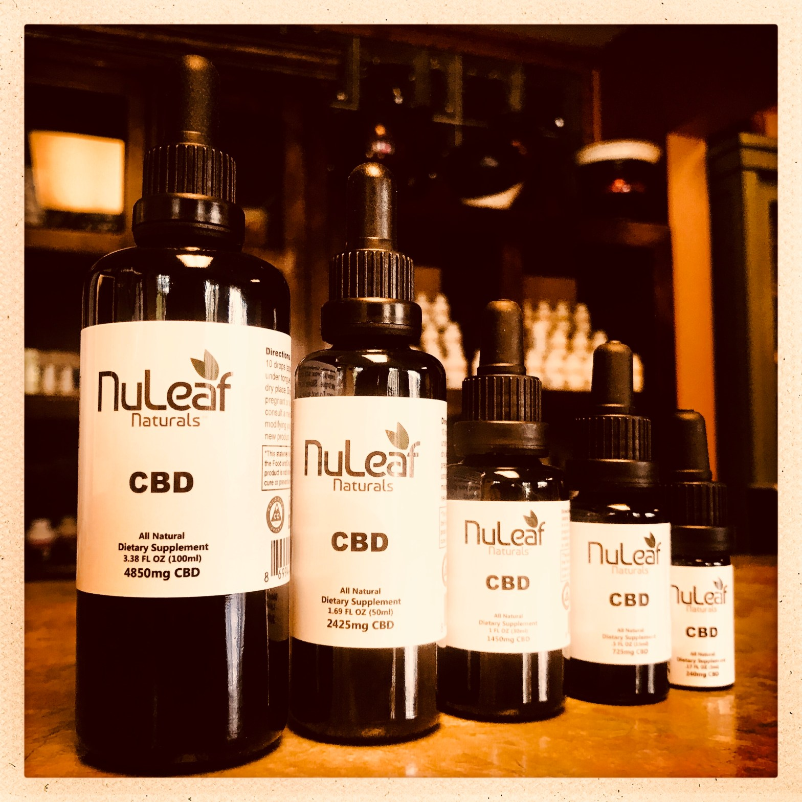 A line up of NuLeaf Naturals 100% Hemp CBD Oil in five different size bottle