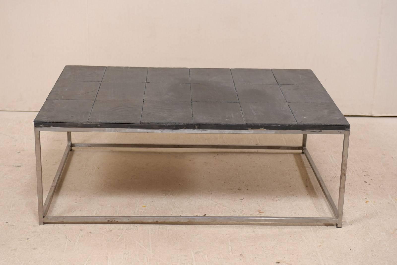 modern style coffee table with slate tiled top and stylish custom metal base