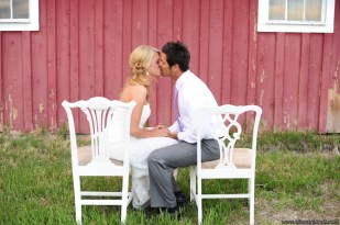 Photographed by Ali Brannan Photography, white vintage chairs next to a colorado barn