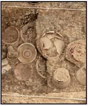 Pottery vessels inside a grave
