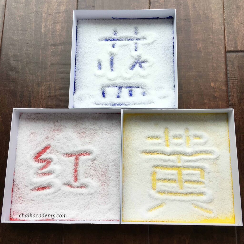 Montessory Salt Writing Tray - Sensory learning with colored background