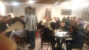 A view of the quizmaster's excellent sparkly jacket.