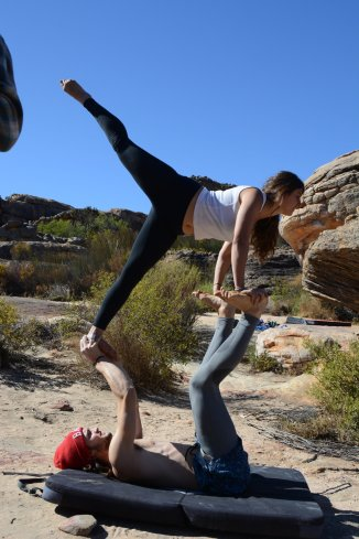 Andy and Kahla having an acro-yoga session at the Rocklands Highline Meeting (Photo credit: David Whitaker)