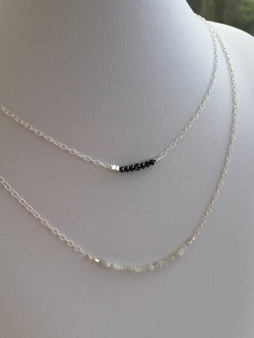 Cut black Diamond and raw white Diamond necklaces.