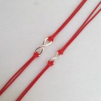 "Couple's ""Forever"" infinity red string bracelets."