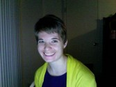 Showing off my haircut, May 2010. Wearing the same purple tunic because I hadn't yet branched out to wearing this with everything.